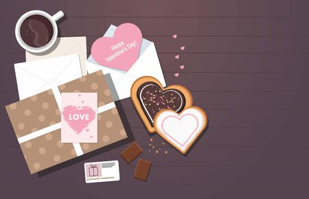 Valentines day composition. Valentine card, mug with coffee, cookies and gift box on the table. Top view. Çizim