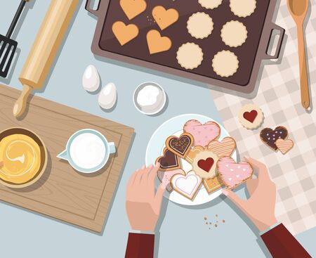 Woman baking. Baking utensils and cooking ingredients for tarts, cookies, dough and pastry. Valentines day. Top view.