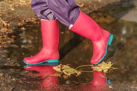 rubber boots. bad weather. puddles. rain.