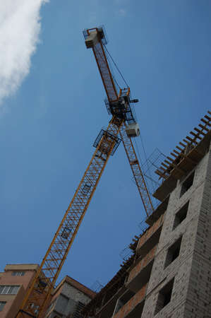 jib: New building. A crane between the building and the sky.