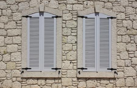 Wall of limestone masonry with windows in the house in Alacati village, Turkey  photo