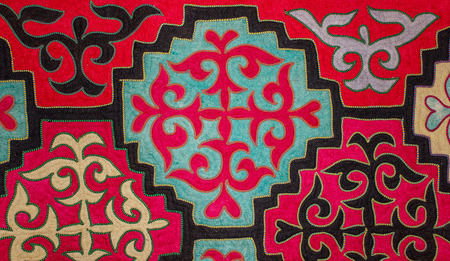 Kazak felt carpet with ornament on the wall of the yurt photo