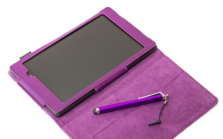 stilus: Tablet computer with stilus on opened purple cover isolated on a white background Stock Photo