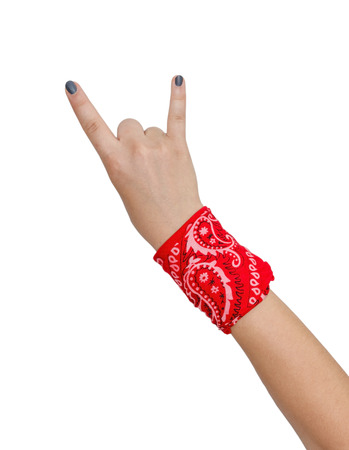 red bandana: female hand with bandana showing rock-n-roll sign isolated on white background