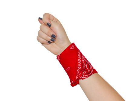 fico: hand with fico and black manicure with knotted bandana isolated on white background Stock Photo