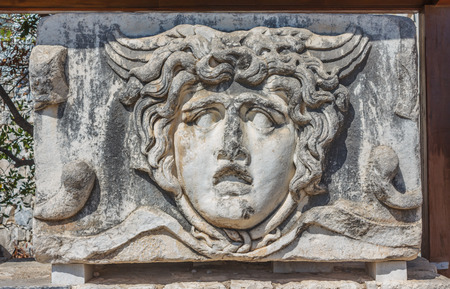 architrave: Part architrave with a frieze with mythical Gorgon Medusa head in ancient Temple of Apollo in Didim, Turkey