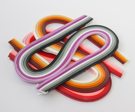 quilling: Sets of multicolored paper for quilling on white background