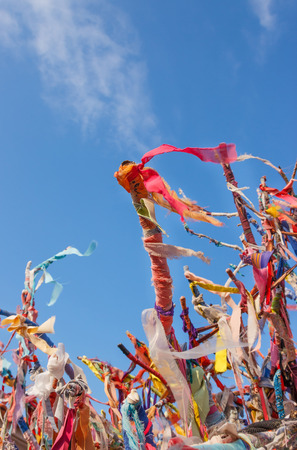 Colorful ribbons and scraps on wishes tree in Cesme, Turkey