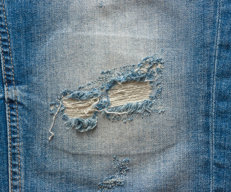 jeans: blue faded ripped jeans closeup