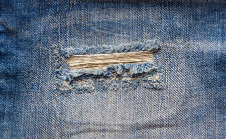 ripped jeans: blue faded ripped jeans closeup