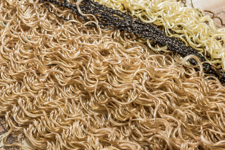 elongation: background from different colors kanekalon material for building African braids Stock Photo