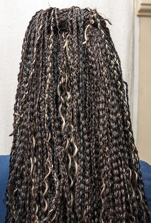 elongation: model with  black and light beige colors kanekalon material African braids on the hair