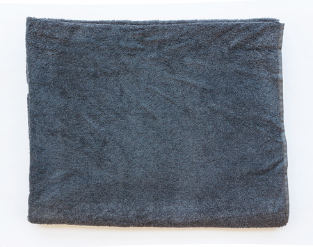 sided: Sided folded gray towel on white background