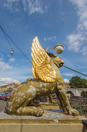 lamp made of stone: SAINT-PETERSBURG, RUSSIA - JULY 16, 2015: Griffins on Bank bridge on the canal Griboyedov