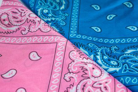 bandanna: Folded blue and pink bandanna on white background