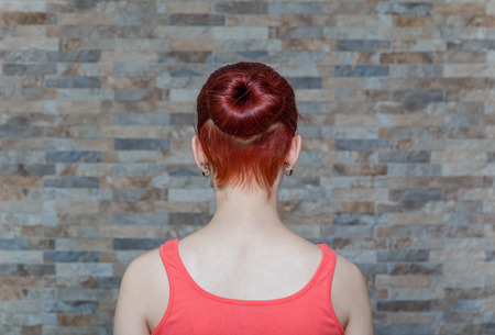 young model with topknot and hidden undercut on hair