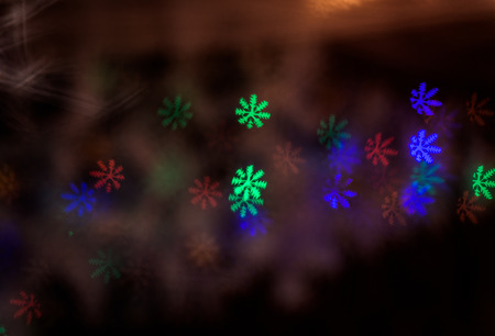figured New Year's  colourful bokeh on dark background Standard-Bild - 97398080