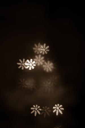 figured New Year's  colourful bokeh on dark background Standard-Bild - 97594504