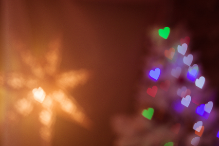 Heart figured New Year's colourful bokeh and star with blur on dark background Standard-Bild - 97532157