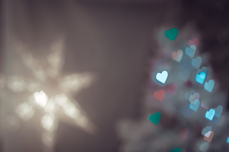 Heart figured New Year's colourful bokeh and star with blur on dark background Standard-Bild - 97594506