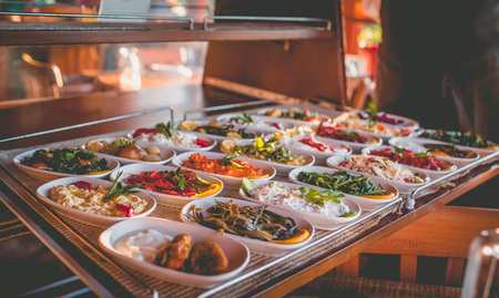 Showcase with a variety of Turkish snacks on small plates. Photo with shallow depth of field Reklamní fotografie