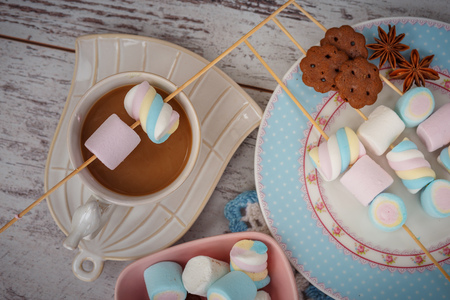 coffee, marshmallow and cookies on gray wooden table. photos are tinted and with a vignette Reklamní fotografie