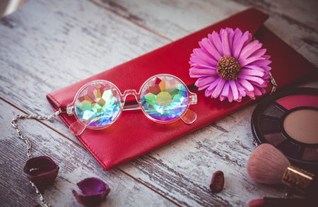 fashionable modern glasses kaleidoscope on wooden table with women accessories Standard-Bild - 110486007