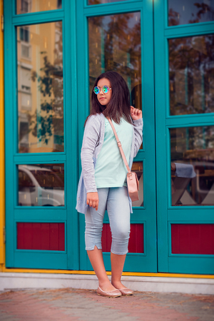 street photo with a young beautiful girl model with dark long hair in glasses kaleidoscopes Reklamní fotografie