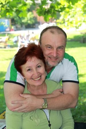 mid thirties: man hugging a  woman