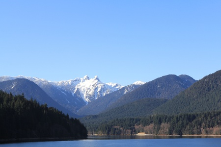 backwoods: Snow-capped peak and forest surrounded by mountains
