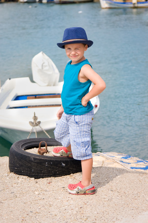 fishman: Little fishman near boat in summer Stock Photo