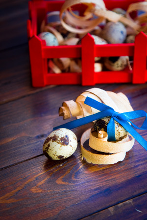 woodenrn: Easter decorations. Quail eggs with bow in box Stock Photo