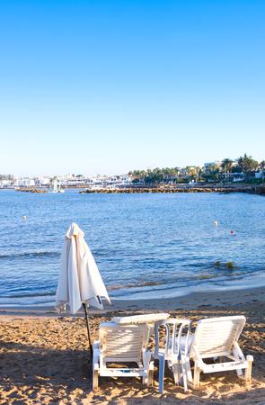 Mediterranean beach with empty sunbeds near sea, Paphos, Cyprus