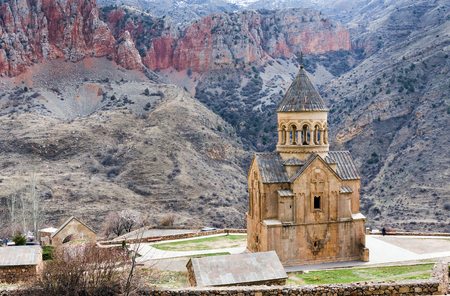 Scenic Novarank monastery in Armenia. Noravank monastery was founded in 1205. It is located 122 km from Yerevan in a narrow gorge made by the Darichay river nearby the city of Yeghegnadzor Imagens