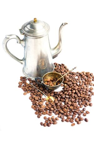 Coffee beans, antique cup and cofeepot on white background