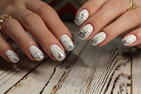 white manicure and fashionable beautiful shiny design