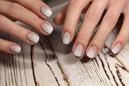 French wedding manicure with flowers and beads