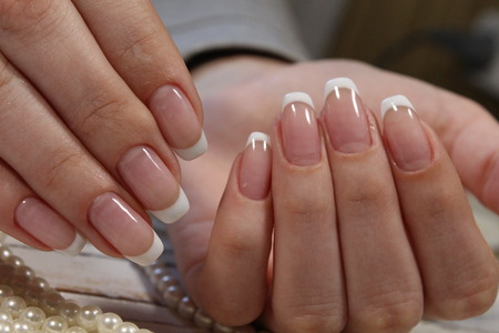 fashionable natural manicure on long beautiful nails