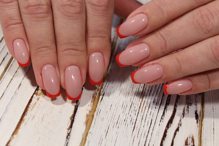 sexy French manicure on long beautiful nails