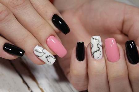 beautiful black manicure on a trendy texture background