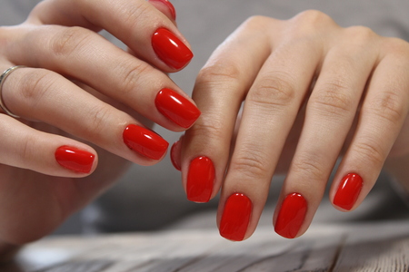 sexy red manicure long nails on the texture Archivio Fotografico