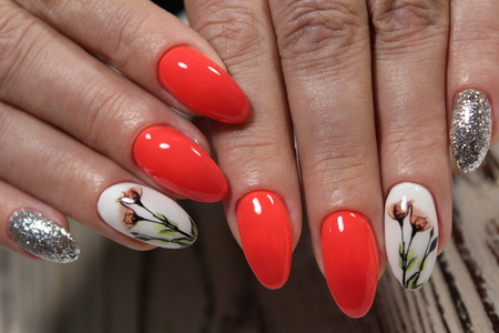 stylish red manicure with a design on a beautiful background