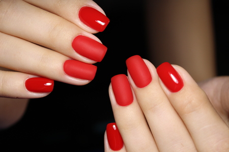 fashionable red manicure on long beautiful nails Banco de Imagens