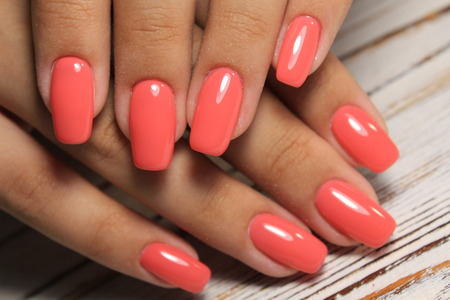 fashionable red manicure on long beautiful nails 写真素材