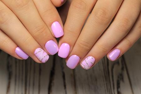 glamorous manicure design on beautiful long nails