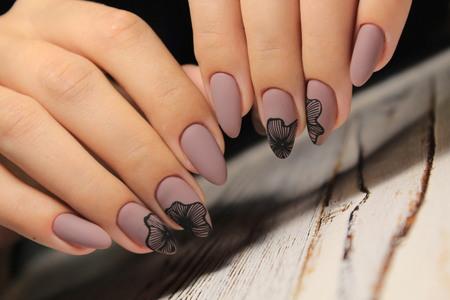 stylish manicure design on beautiful long nails Standard-Bild - 110747428