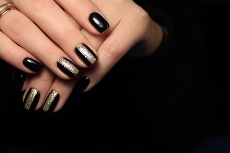 beautiful black manicure with a design on long nails