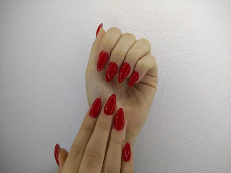 beautiful female hands with a fashionable manicure on the background Stock Photo