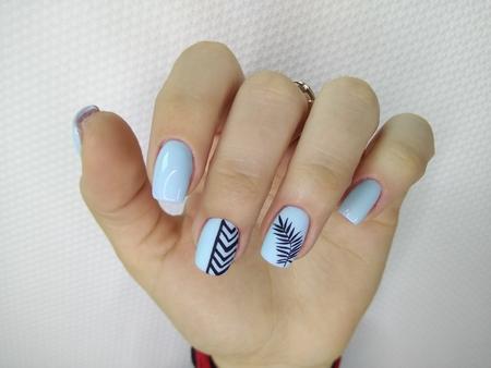 glamorous blue manicure on beautiful female hands