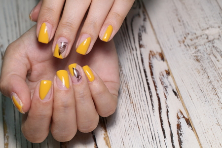 beautiful manicure of nails on the background of a fashionable texture Reklamní fotografie